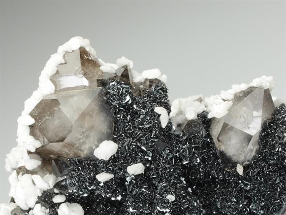 Calcite on Quartz and Hematite