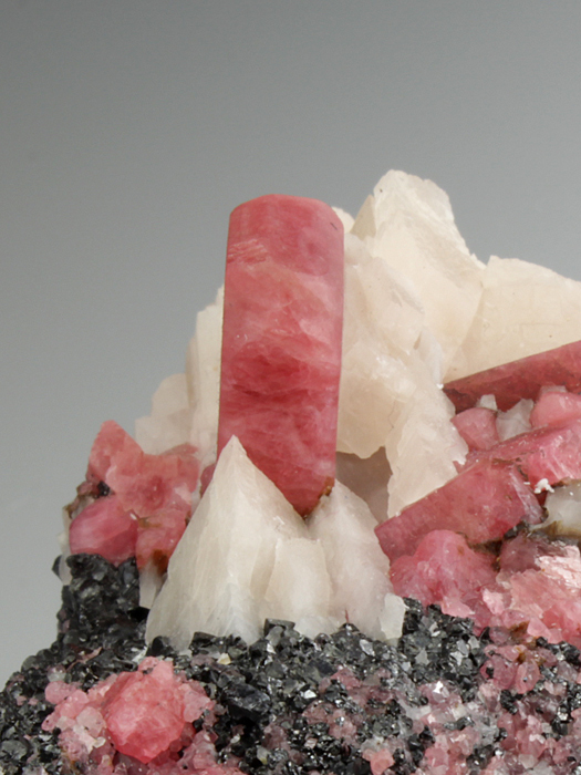 Rhodonite With Calcite on Franklinite