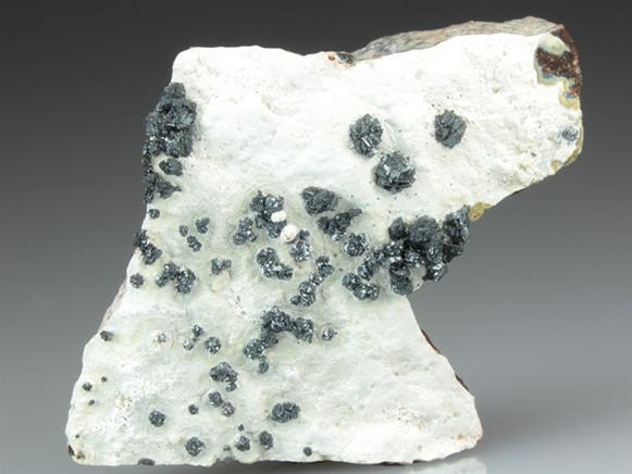 Hetaerolite on Lizardite