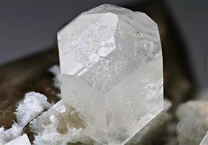 Phenakite on Smoky Quartz With Feldspar