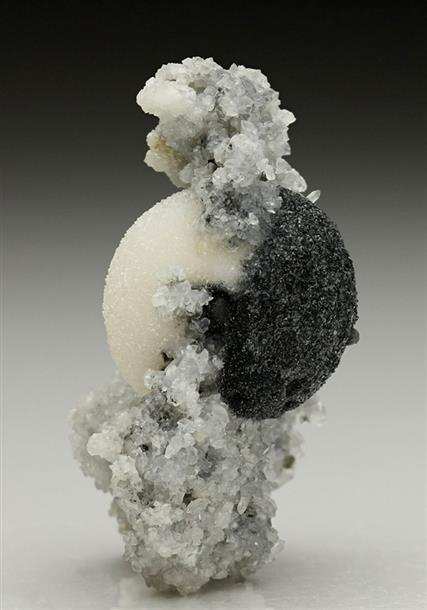 Calcite half Boulangerite Incuded