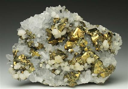 Chalcopyrite, Pyrite and Calcite on Quartz
