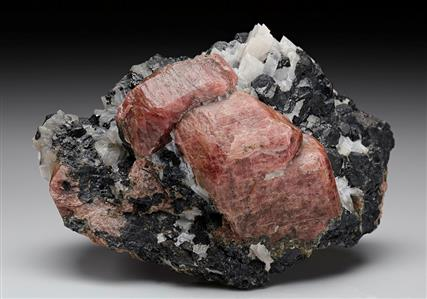 Rhodonite with Franklinite in Calcite