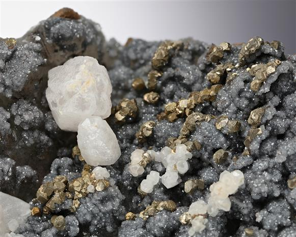 Calcite and Pyrite on Quartz